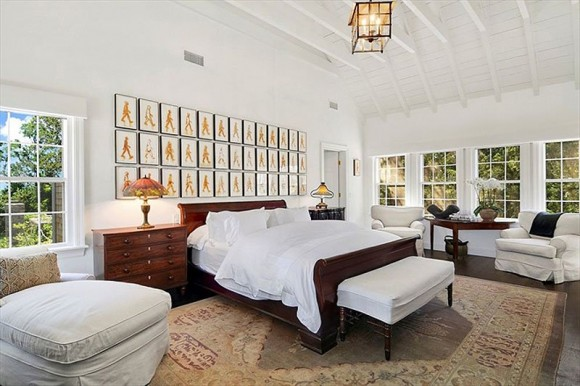 heres-the-sprawling-master-bedroom-with-lounge-chairs-and-a-vaulted-ceiling
