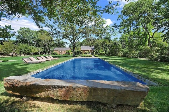 the-swimming-pool-is-heated-and-shaded-by-trees