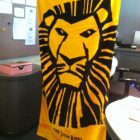 Nikki Strong shows off Lion King Towel that crew members brought to the studio!