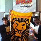 Nikki Strong and WHUR Intern Mariya Moseley show off Lion King towel.