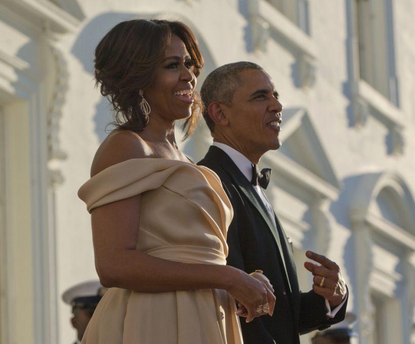 Barack Michelle Obama dinner_ AP Images